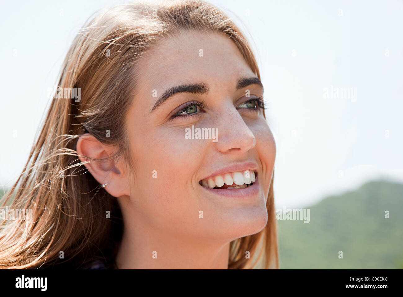 Close up portrait of blonde haired young woman - Stock Image