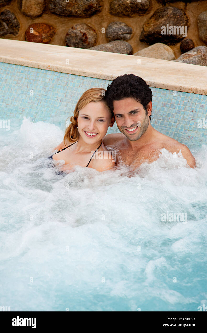 Young couple in hot tub, portrait - Stock Image