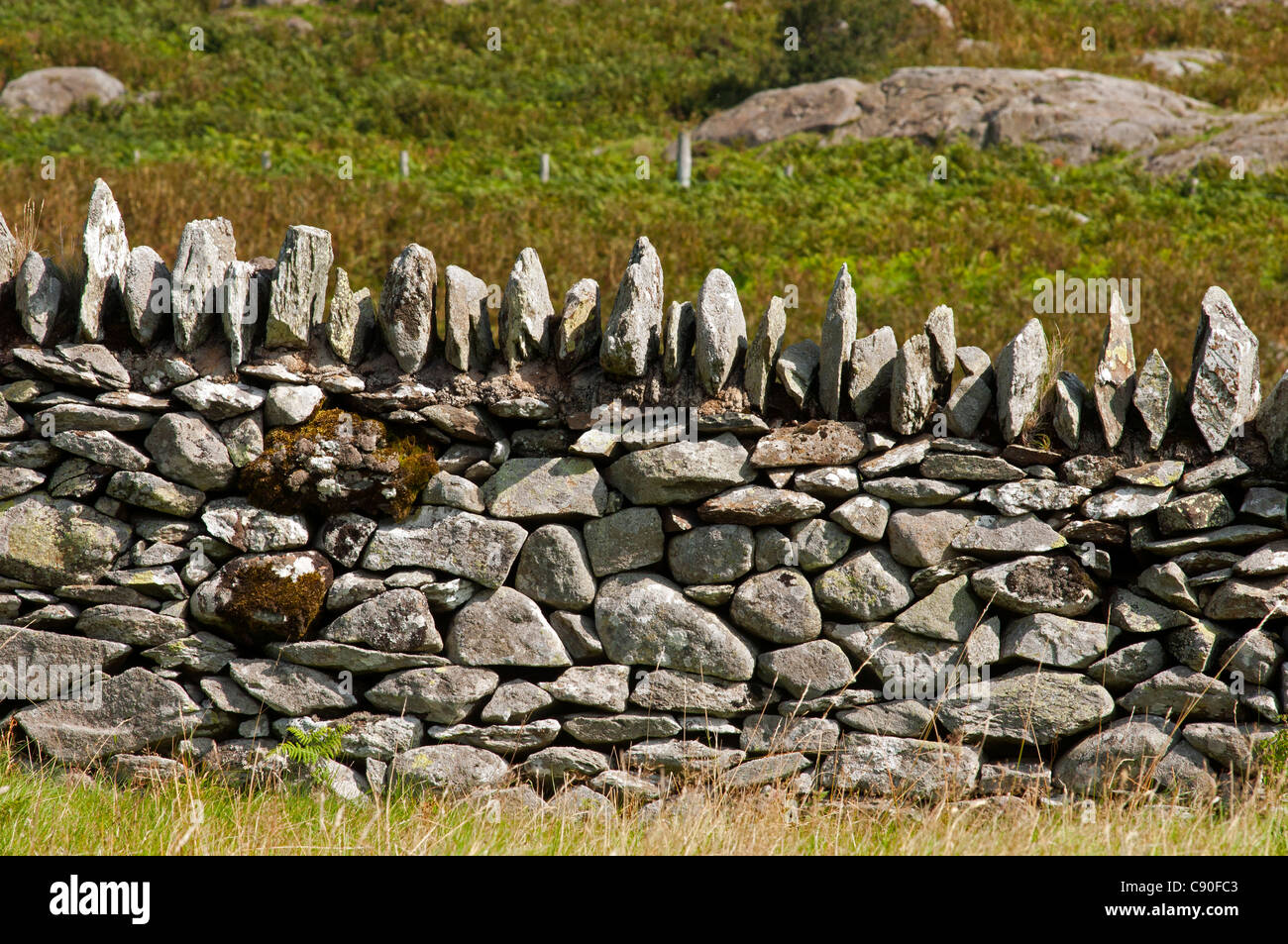 Stone wall of St. Celynin's church above Rowen, Snowdonia National Park, Wales, UK - Stock Image