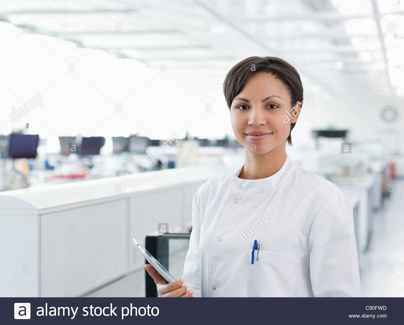 Scientist holding tablet computer in lab - Stock Image