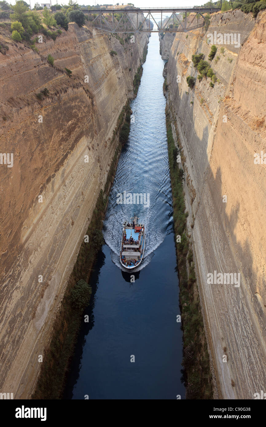 Tourist boat on the Corinth Canal which connects the Gulf of Corinth with the Saronic Gulf in the Aegean Sea Stock Photo