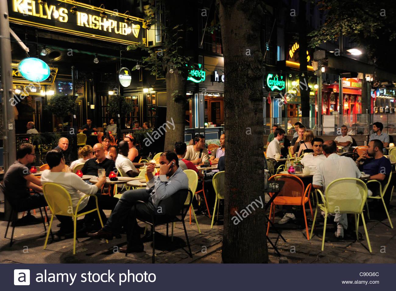 Sidewalk cafe in the evening, De Keyserlei street, city centre, Antwerp, Anvers, Flanders, Belgium, Benelux - Stock Image