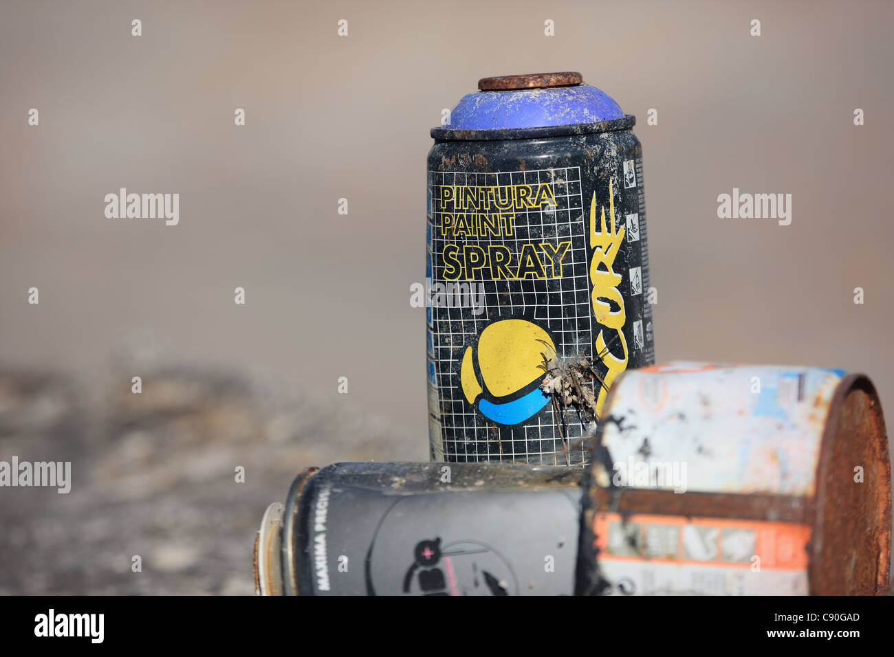 spray paint cans discarded after being used for graffiti - Stock Image