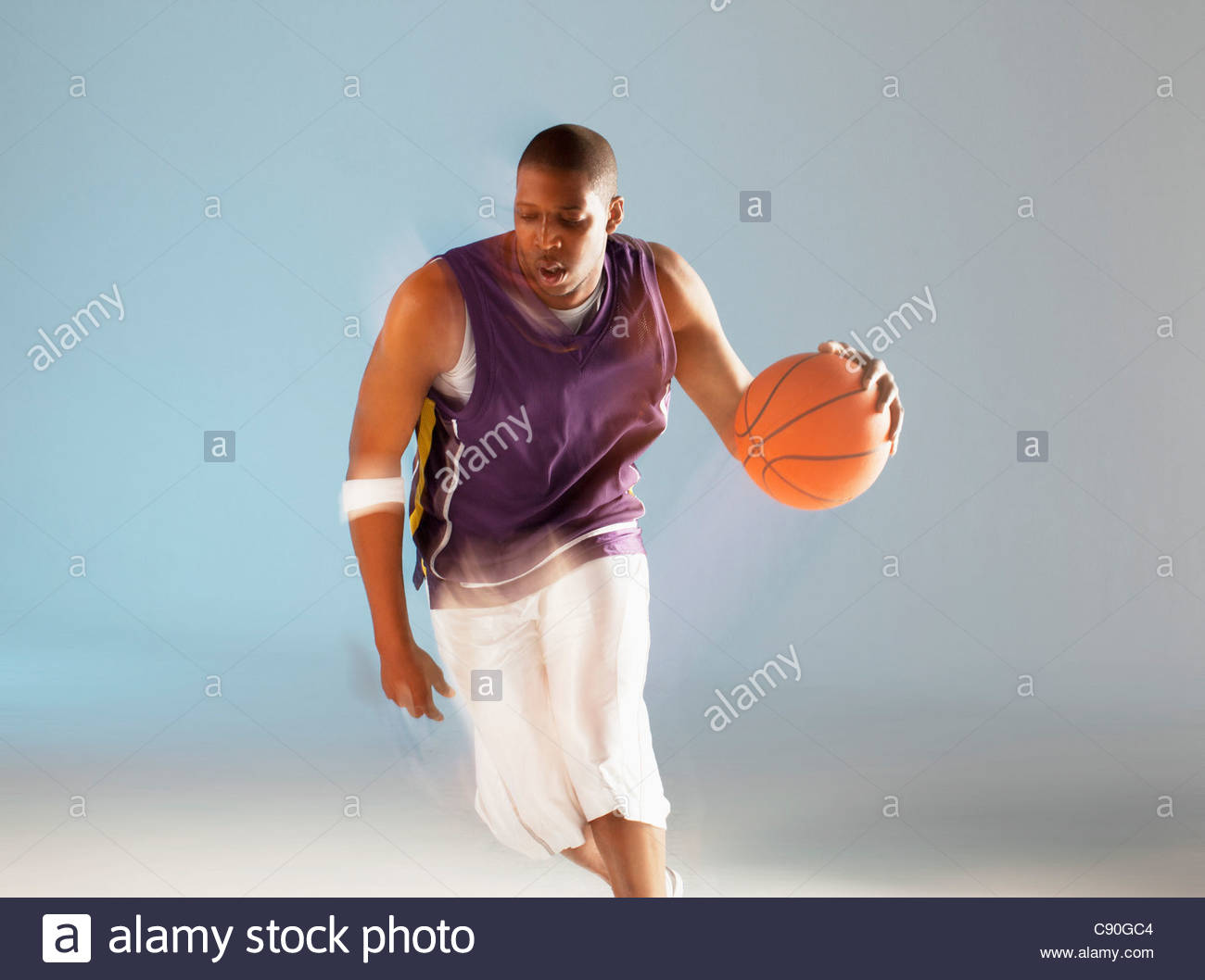 Blurred view of basketball player dribbling - Stock Image