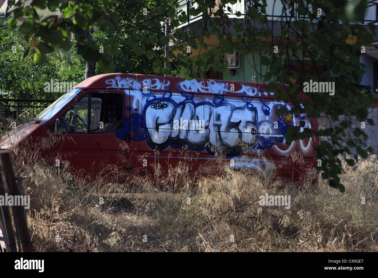 Van covered in Graffiti in Athens Greece - Stock Image