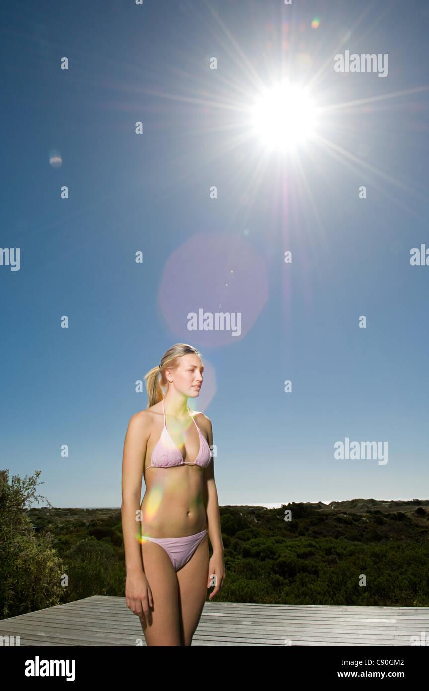 Young woman in pink bikini - Stock Image