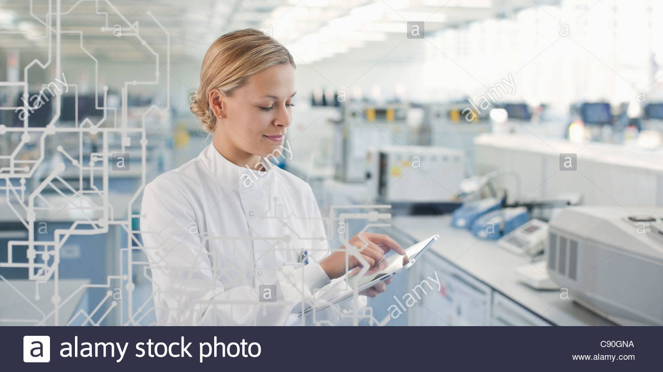 Scientist using touch screen in lab - Stock Image