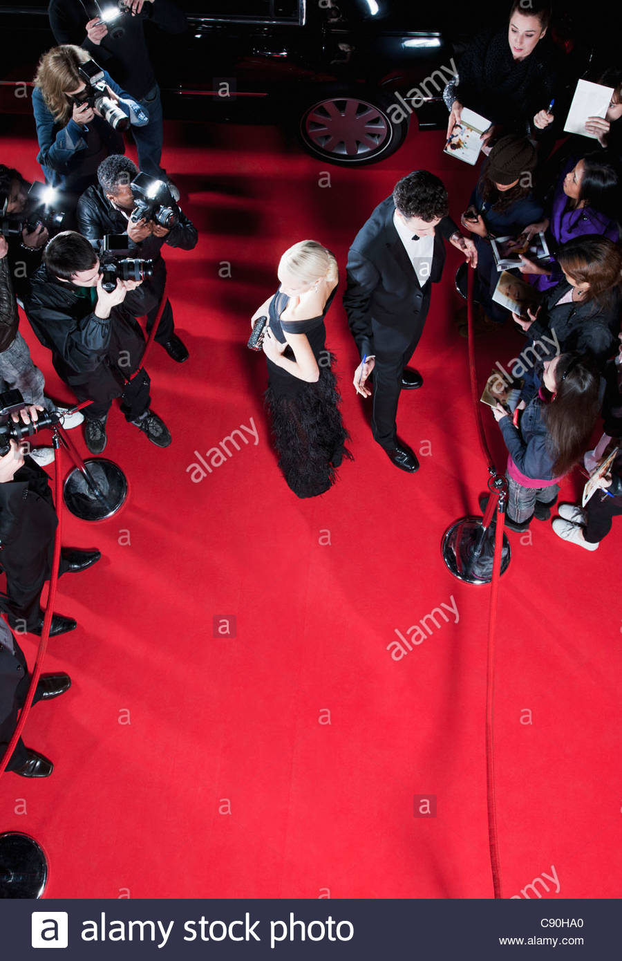 Celebrities working on red carpet - Stock Image