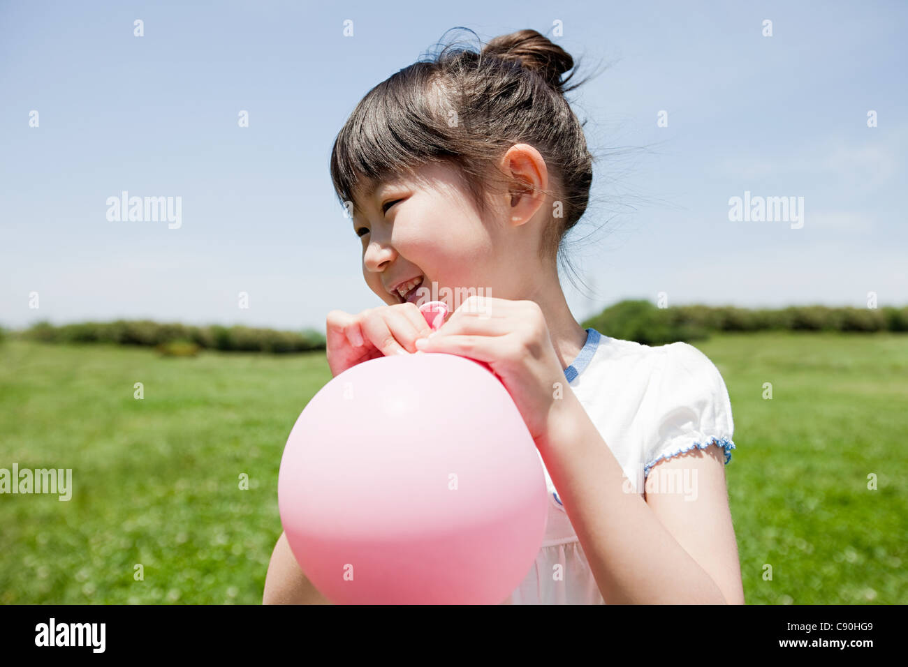 Girl with pink balloon - Stock Image
