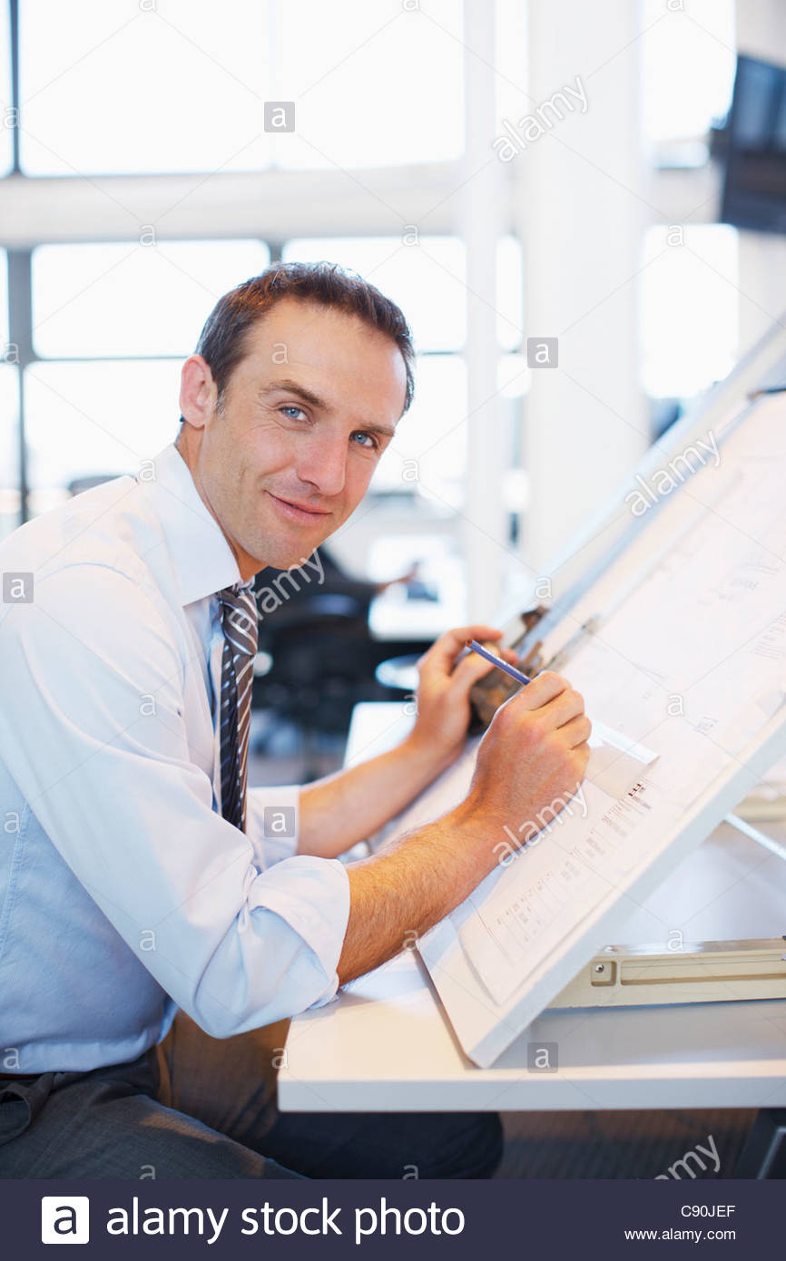 Architect working at desk - Stock Image