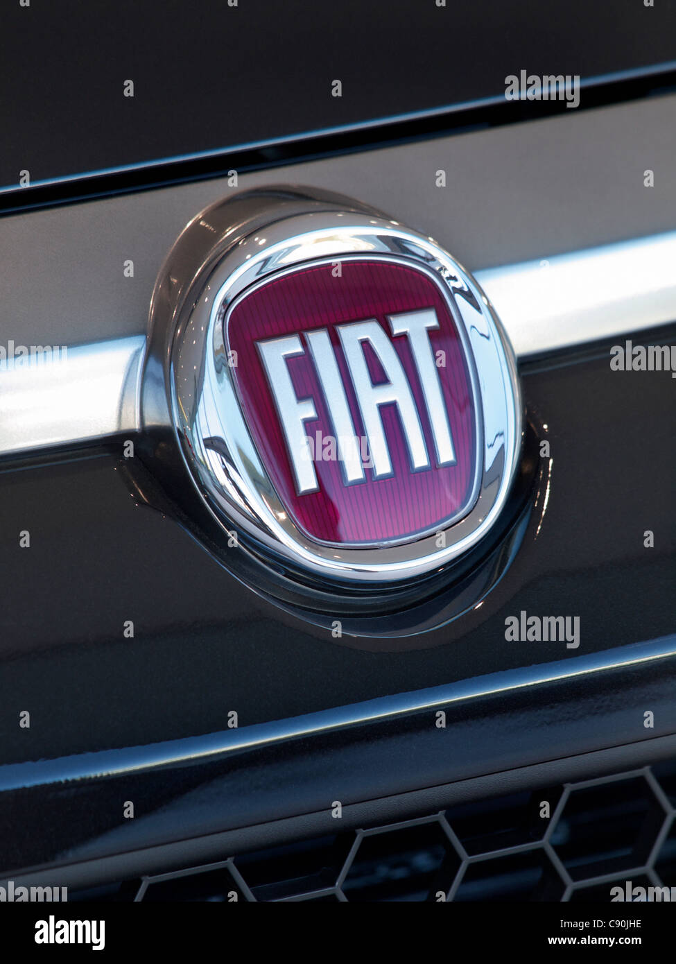Fiat Logo Badge On The Front Of A Fiat Punto Car Fiat Is An Acronym Stock Photo Alamy