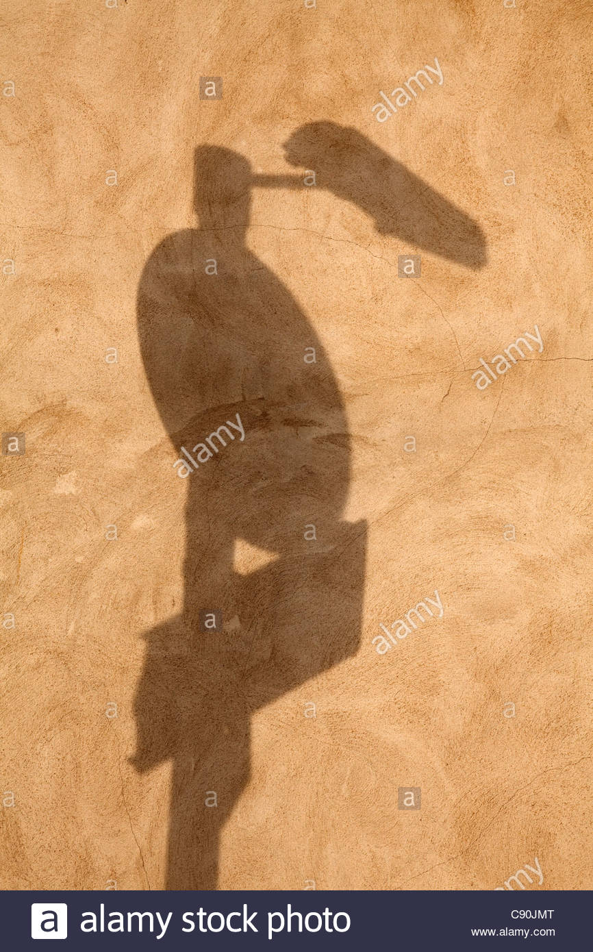 Street furniture shadow on a rendered wall - Stock Image