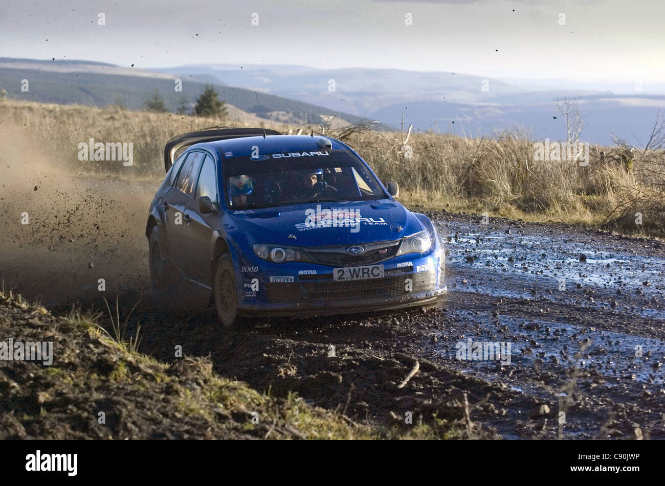 Petter Solberg on the Resolven stage of the Wales Rally GB in the forests of South Wales in 2008. - Stock Image