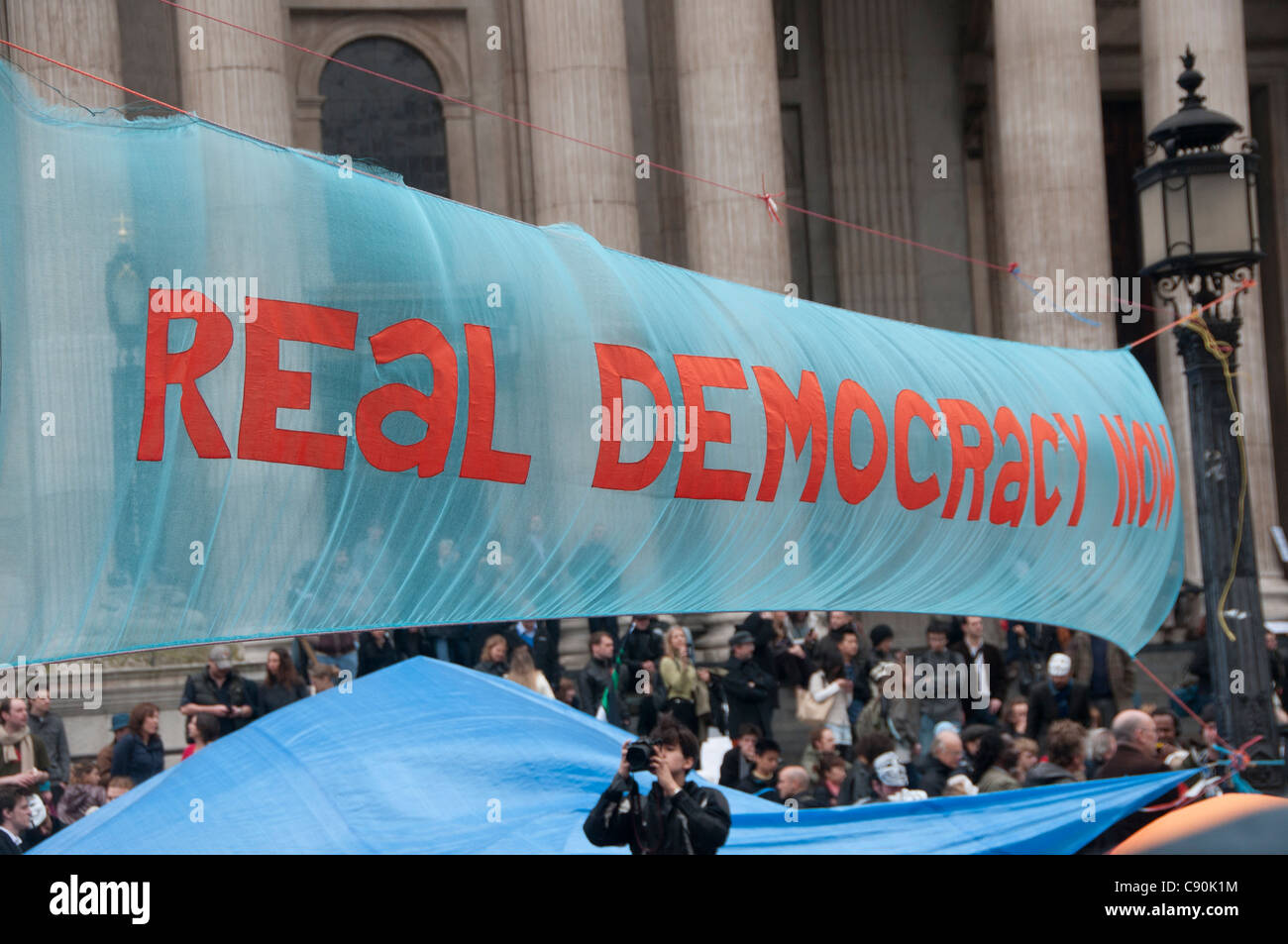 Occupy London. St Paul's. Protest against the city and banks. Banner saying Real Democracy now - Stock Image