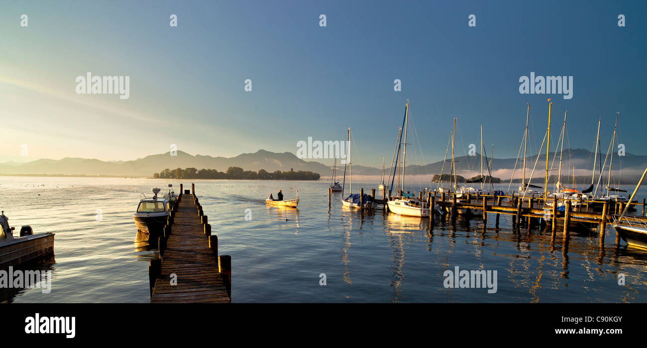 Morning mood in Gstadt with a view on Fraueninsel, Chiemsee, Chiemgau, Upper Bavaria, Bavaria, Germany Stock Photo