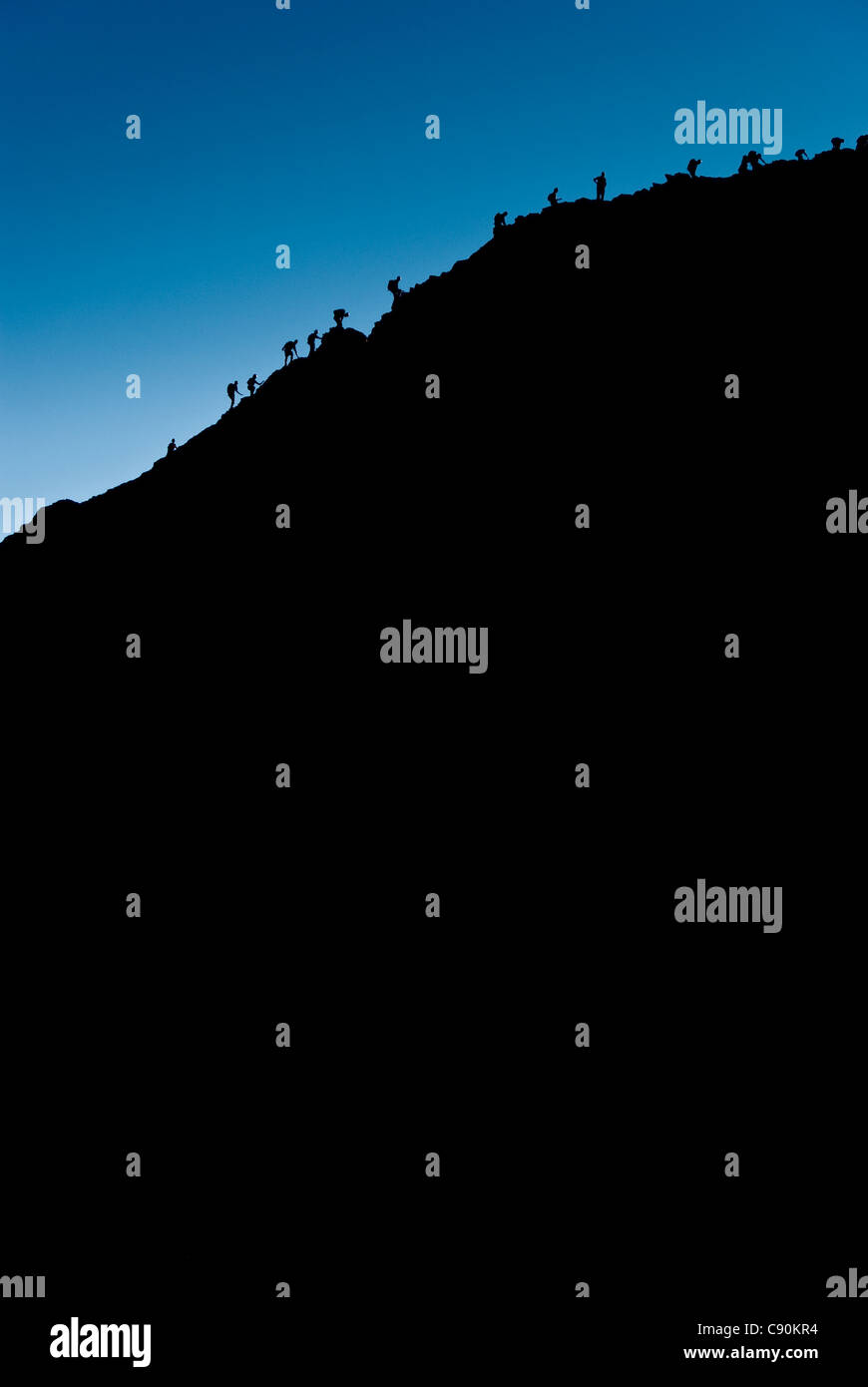 Silhouette of walkers climbing Sharp Edge on Blencathra, Lake District, Cumbria - Stock Image
