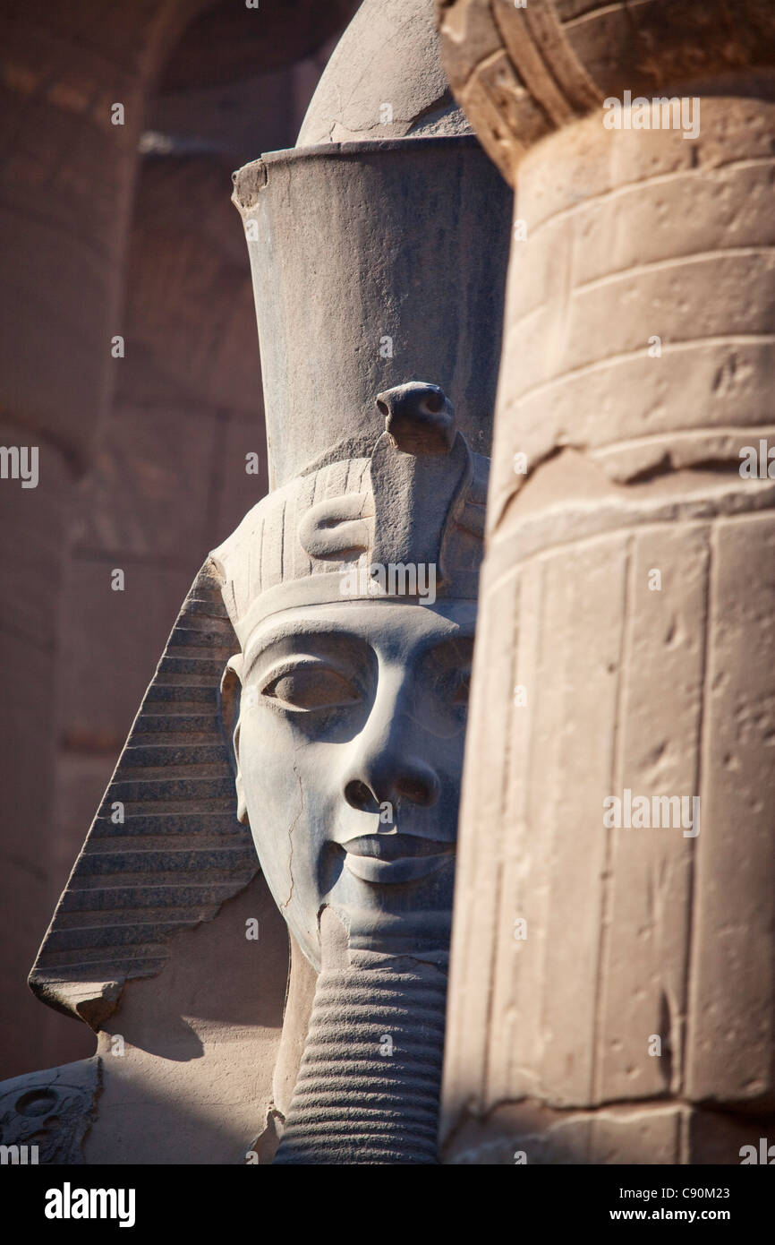 Colossal statue of Ramesses II in the entrance area of Luxor Temple, Luxor, Egypt, Africa - Stock Image