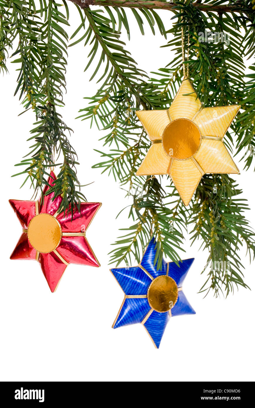 colorful star as decoration on Christmas tree - Stock Image
