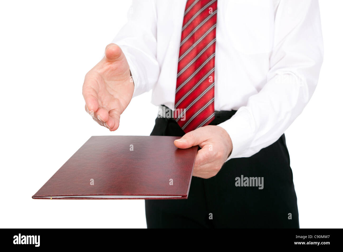 man passes document of second person on white background - Stock Image
