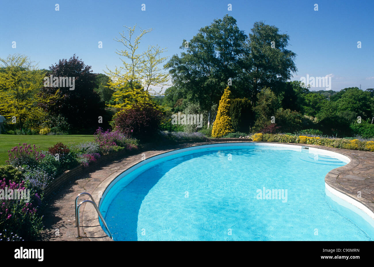 Many houses now have swimming pools in the gardens in the Home counties like Buckinghamshire, England. - Stock Image