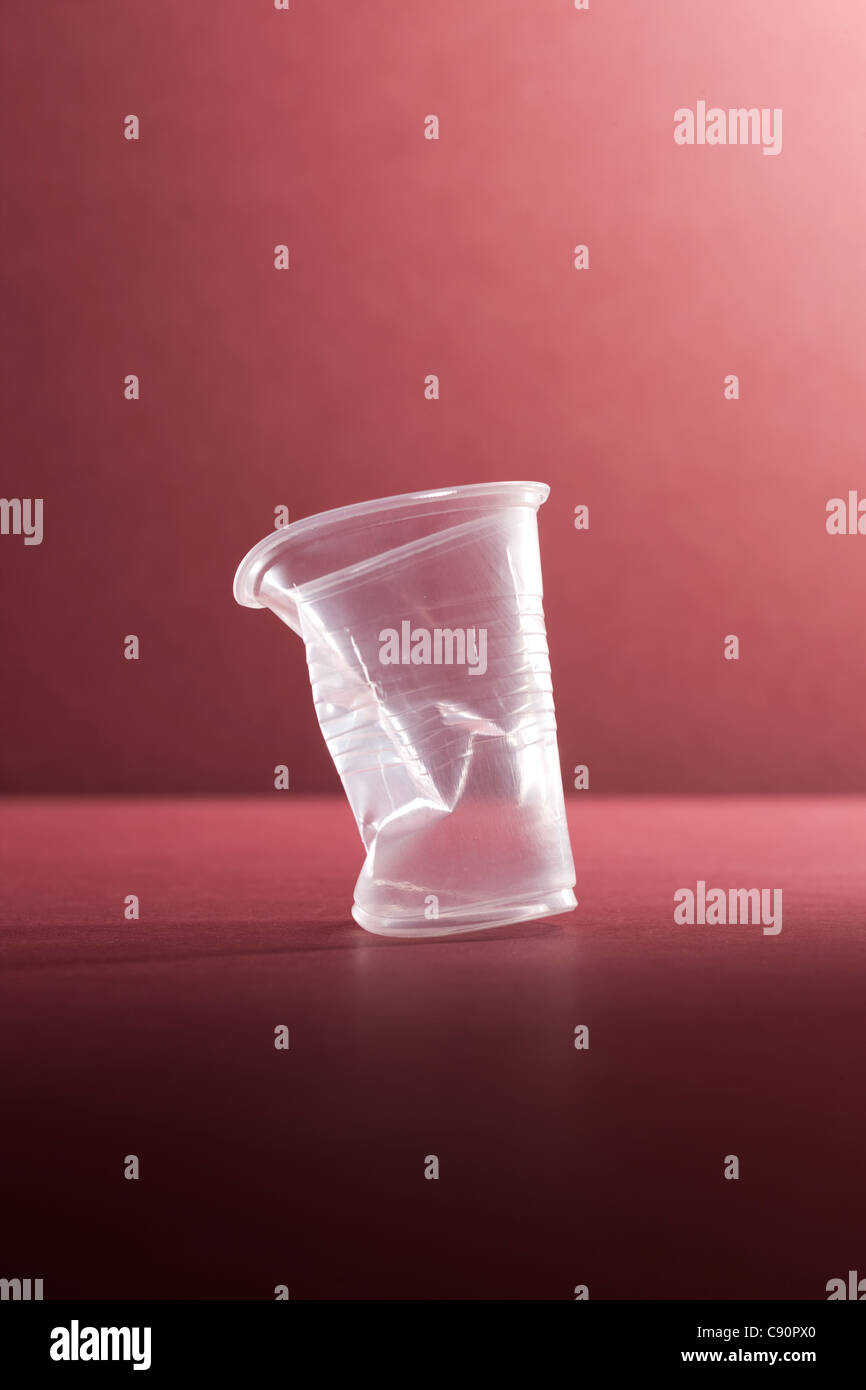Crushed empty plastic cup, still life - Stock Image