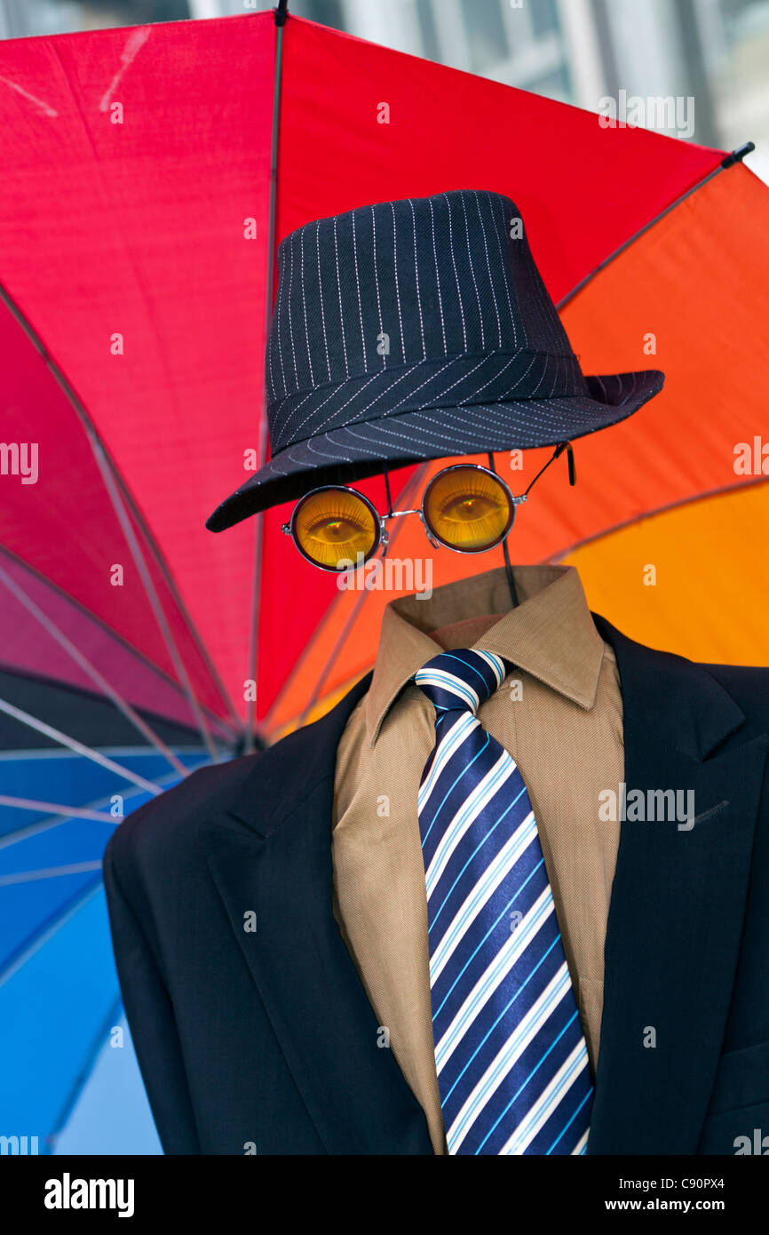 Funny street performer with colourful umbrella, Stroget pedestrian shopping zone, Copenhagen, Denmark - Stock Image