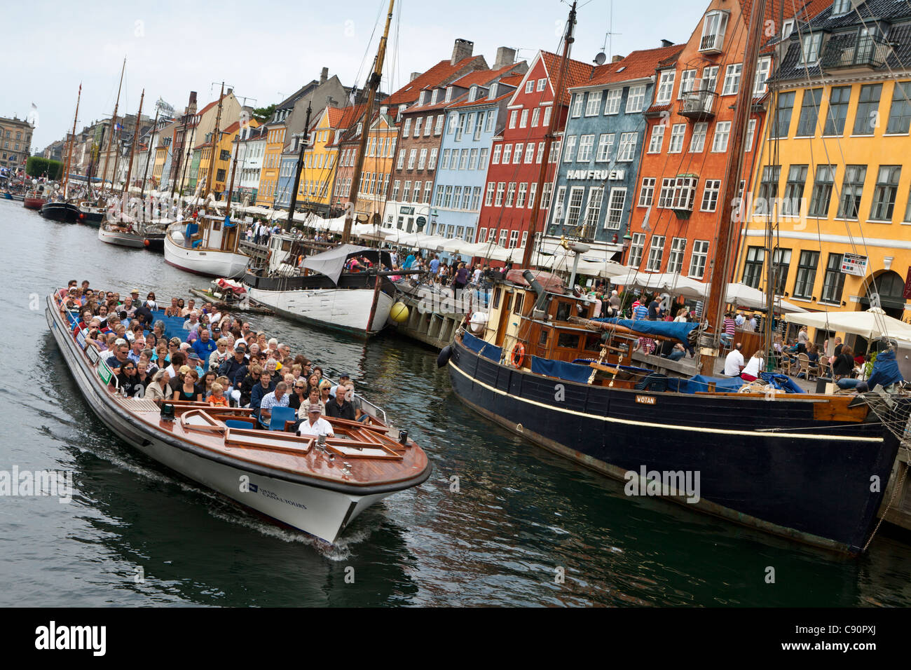 Tourists on a canal cruise, Nyhavn, Copenhagen, Denmark - Stock Image