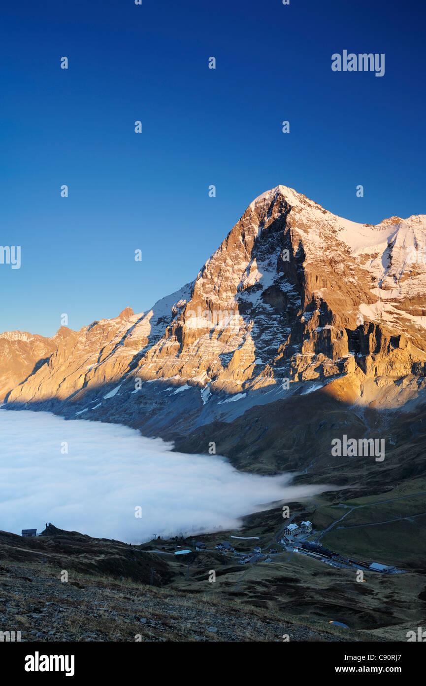 Alpenglow at Eiger above Kleine Scheidegg, sea of fog above Grindelwald, Kleine Scheidegg, Grindelwald, UNESCO World - Stock Image