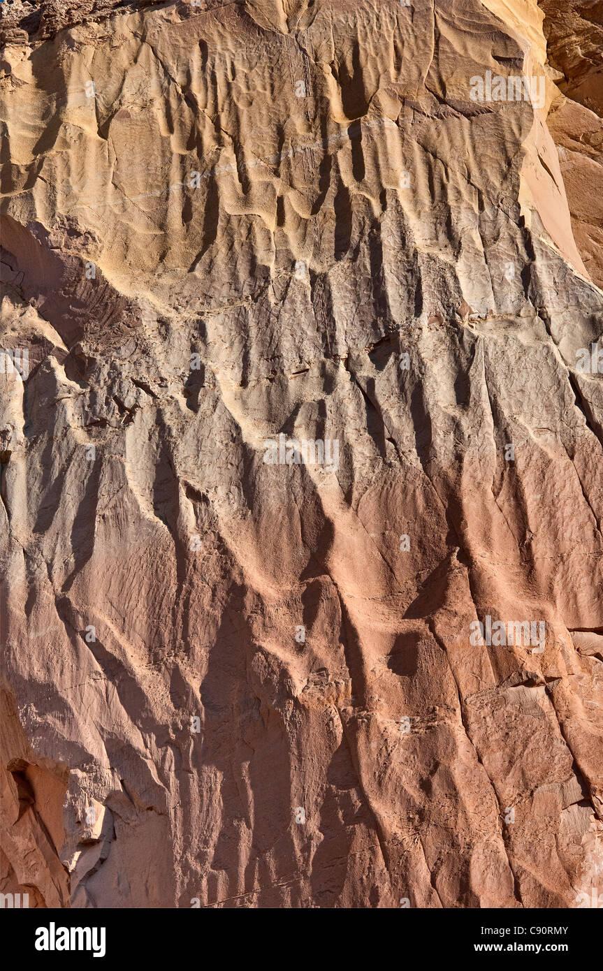 Rock face at Echo Amphitheater natural rock alcove in a cliff at Mesa de las Viejas near Abiquiu, New Mexico, USA - Stock Image