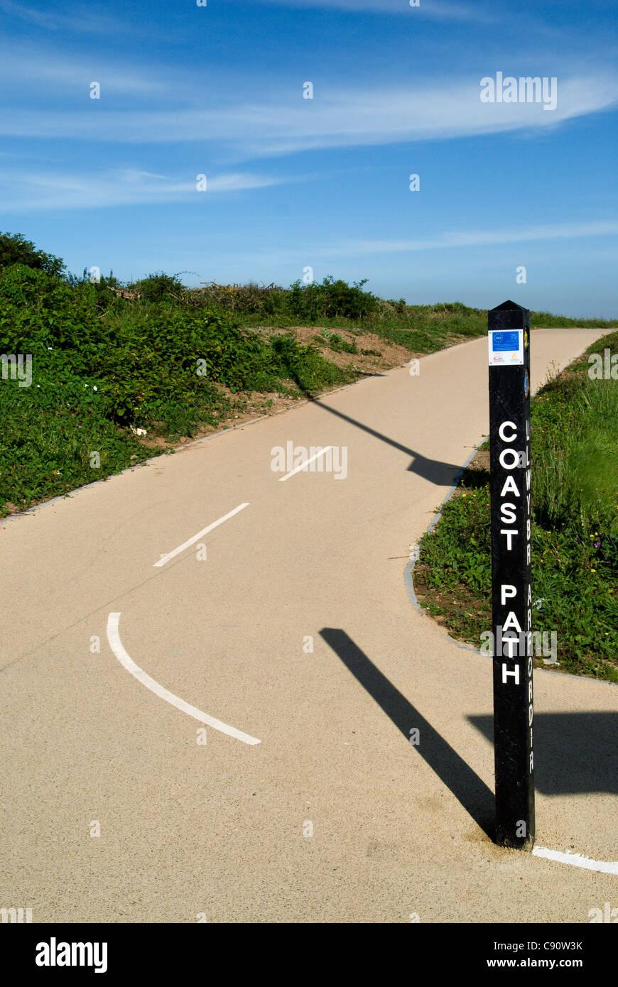 coastal footpath and sign porthcawl glamorgan south wales uk - Stock Image