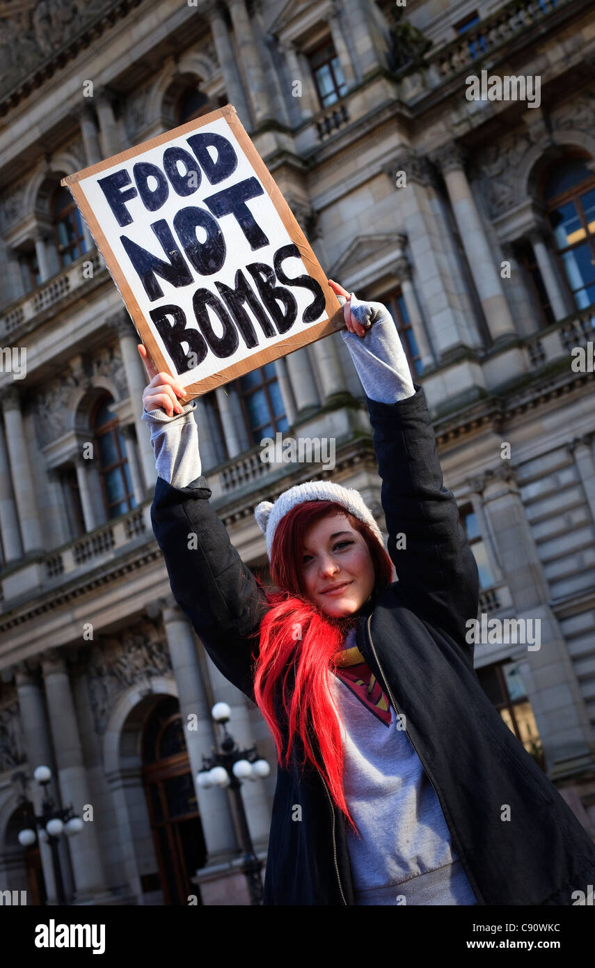 Katy Arthur protesting about the world economy and the social inequality in the world, Glasgow, Scotland - Stock Image