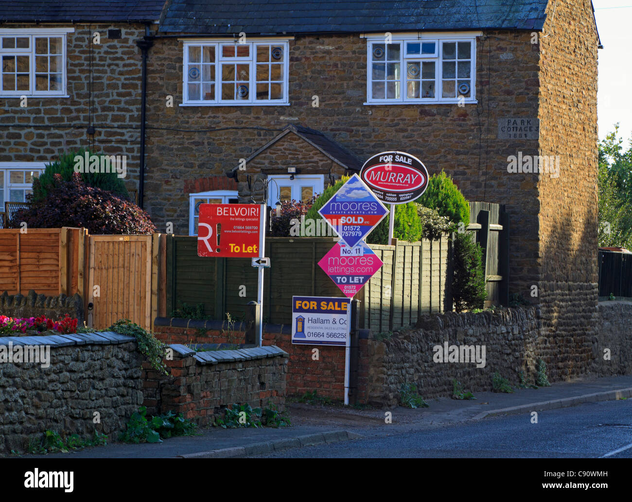 Signs for houses and cottages for sale and to let. - Stock Image