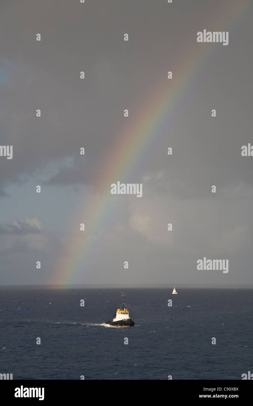 There are tropical storms and atmospheric conditions which often produce rainbows in the skies over the islands - Stock Image
