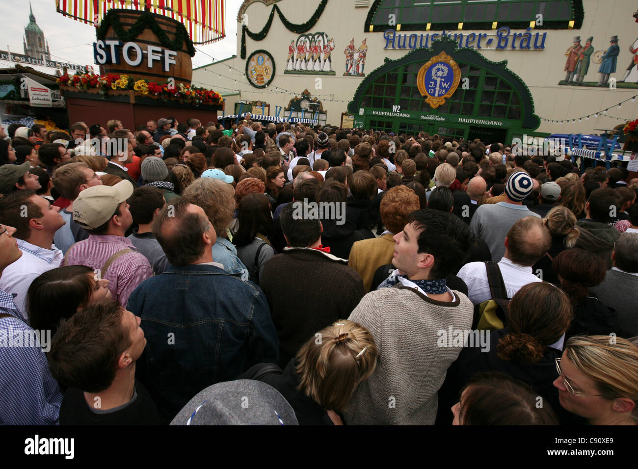 Huge crowd in front of the Augustiner Festhalle on the first day of the Oktoberfest Beer Festival in Munich, Germany. Stock Photo