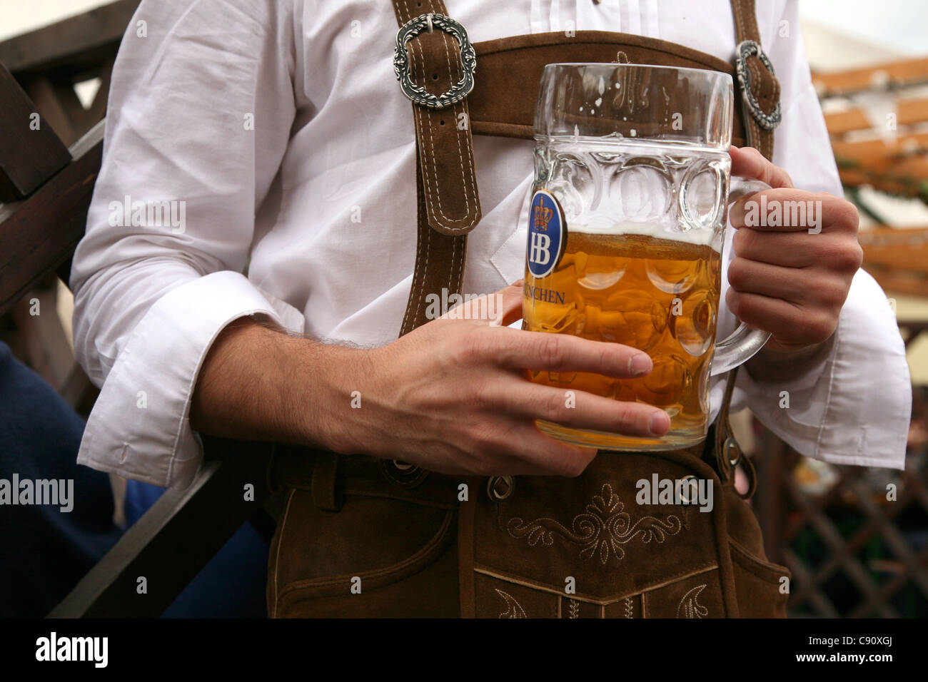 Traditional one litre beer mass at the Oktoberfest Beer Festival in Munich, Germany. Stock Photo