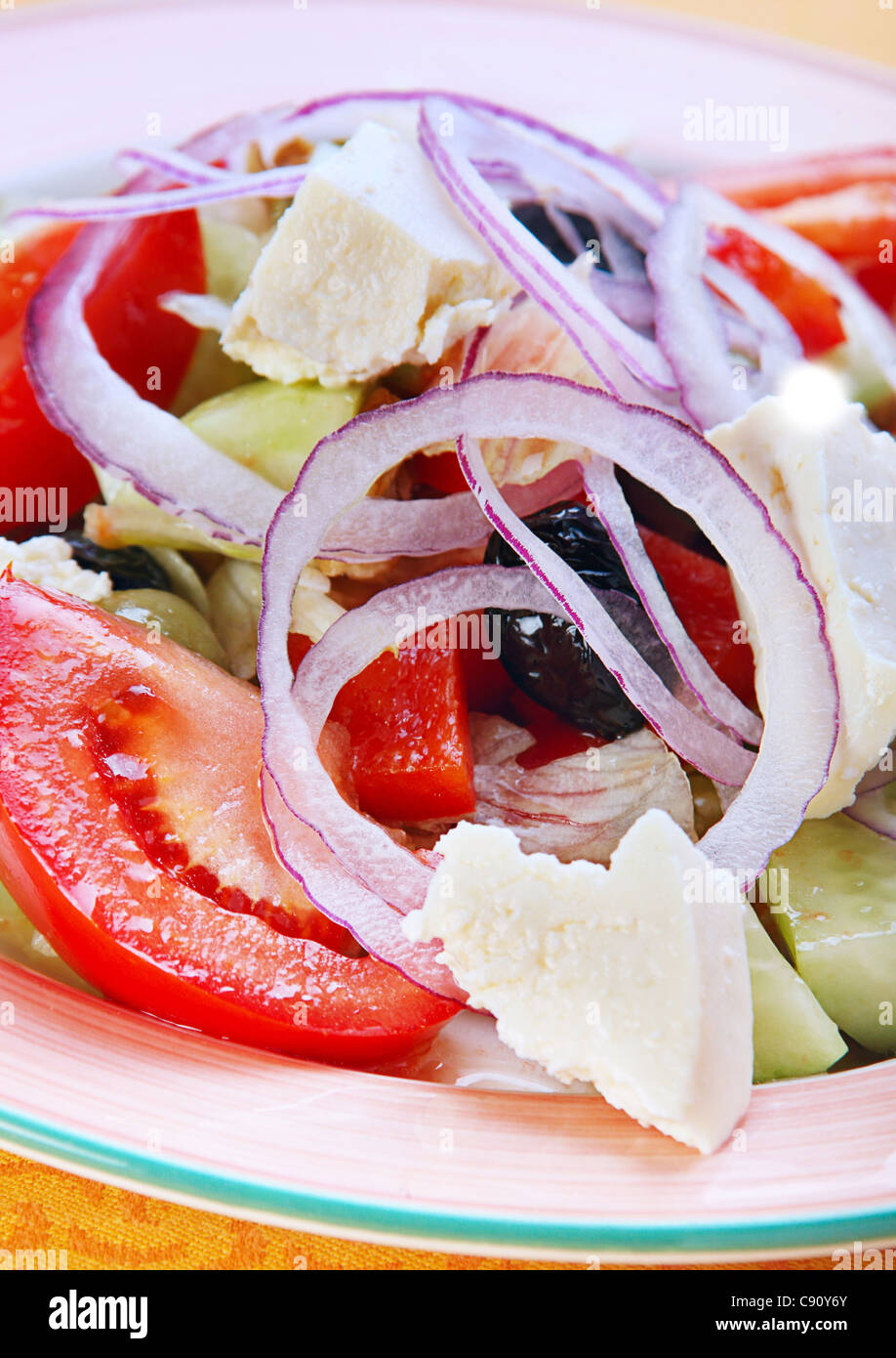 Salad with feta cheese and tomato - Stock Image