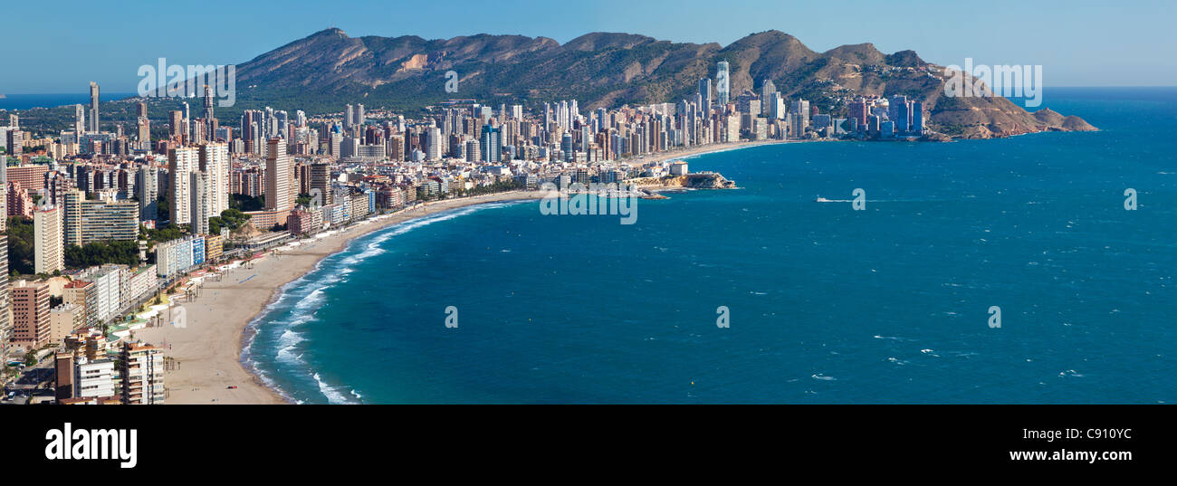 Complete panoramic aerial view of Benidorm sandy beaches Poniente and Levante at daylight, with the old town and - Stock Image