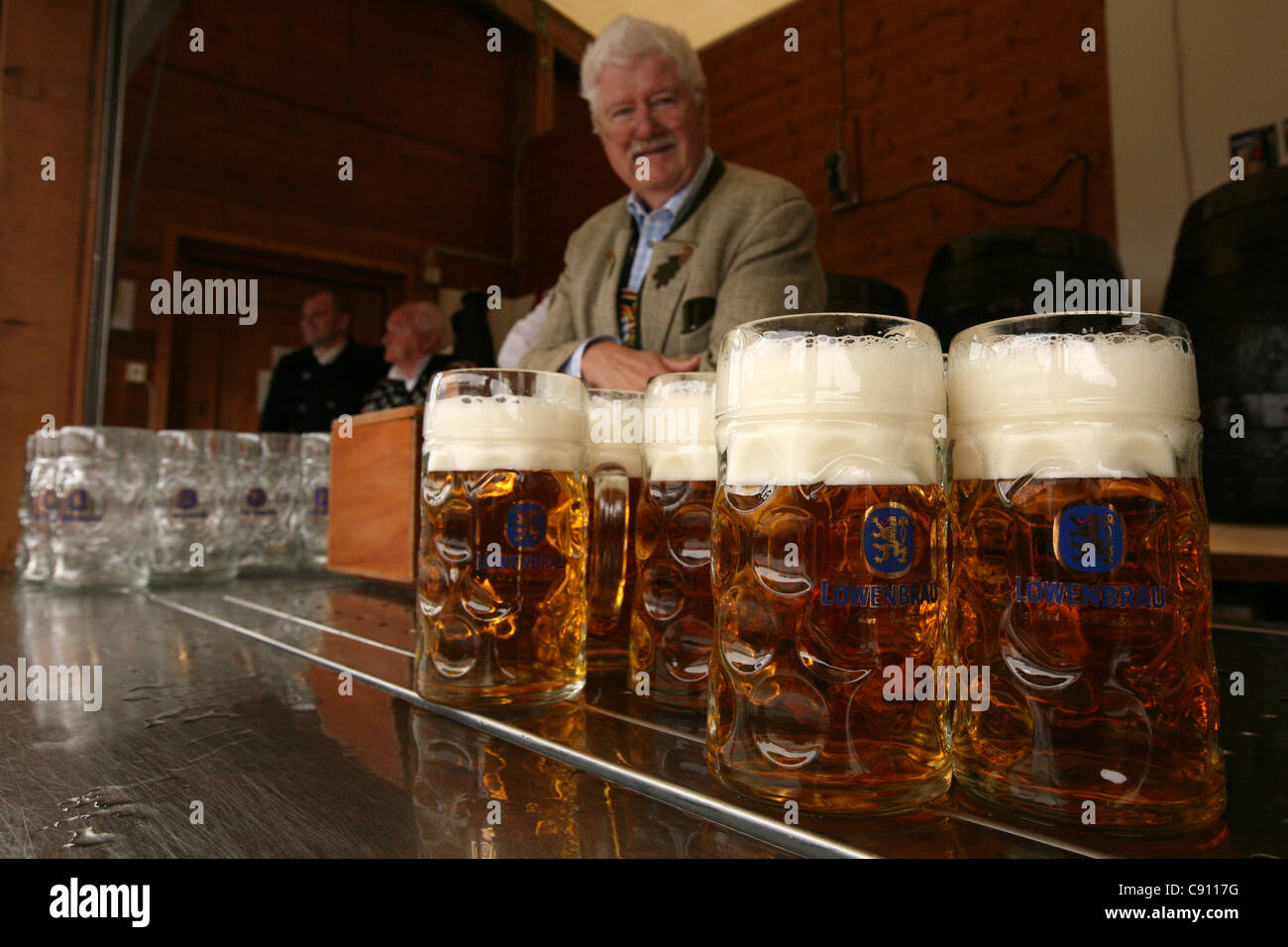 Barmen in the Lowenbrau Festhalle at the Oktoberfest Beer Festival in Munich, Germany. Stock Photo