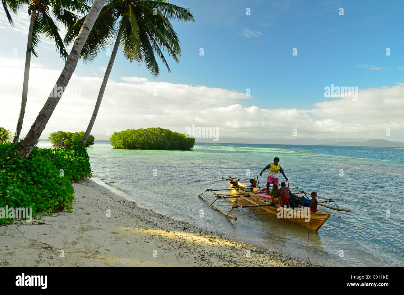 Papuan fishermen arrive at Paniki Island, Raja Ampat islands near West Papua, Indonesia in the coral triangle, Pacific - Stock Image
