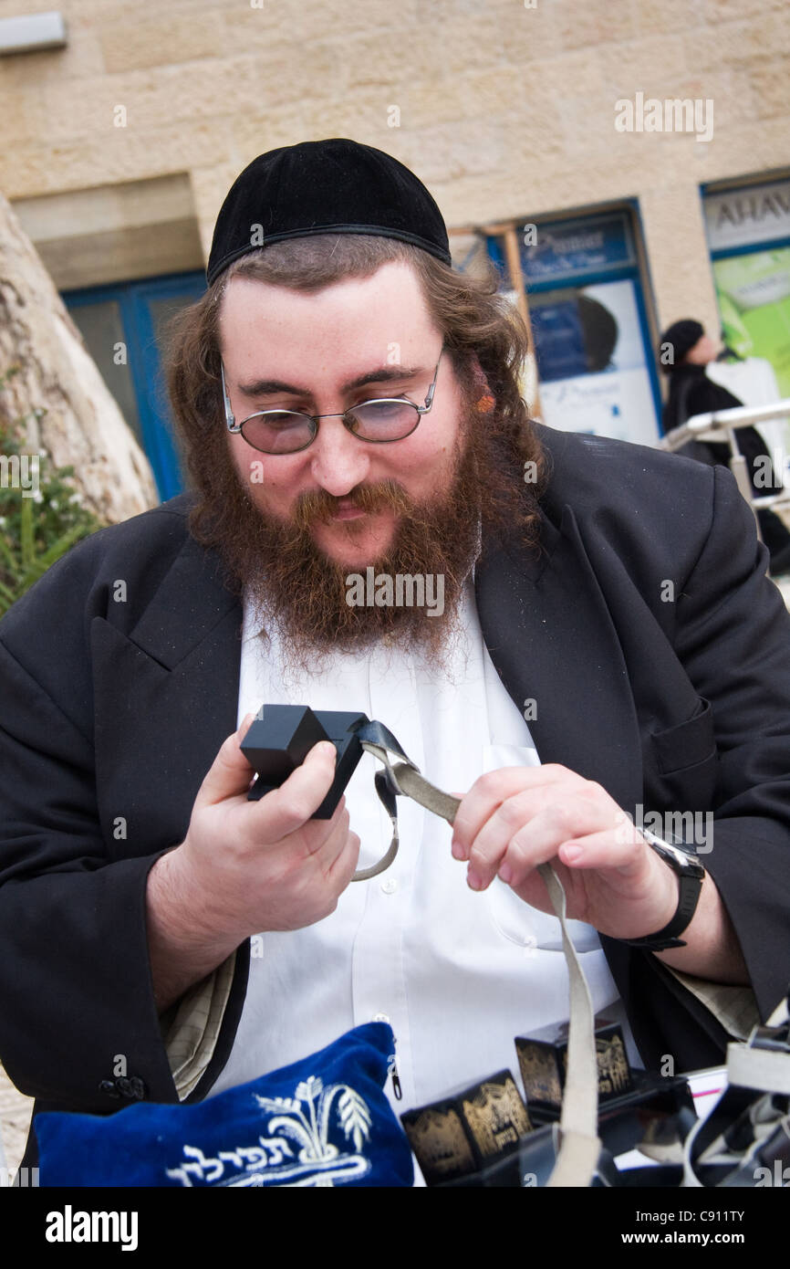 An Orthodox Jew makes Tefillin also called phylacteries in Jerusalem in Israel - Stock Image