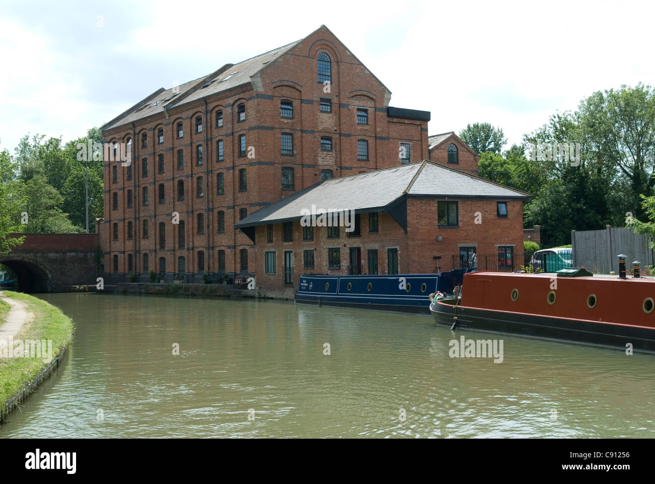 At Blisworth Mill on the Grand Union Canal there are historic buildings from the era when the canals provided the - Stock Image