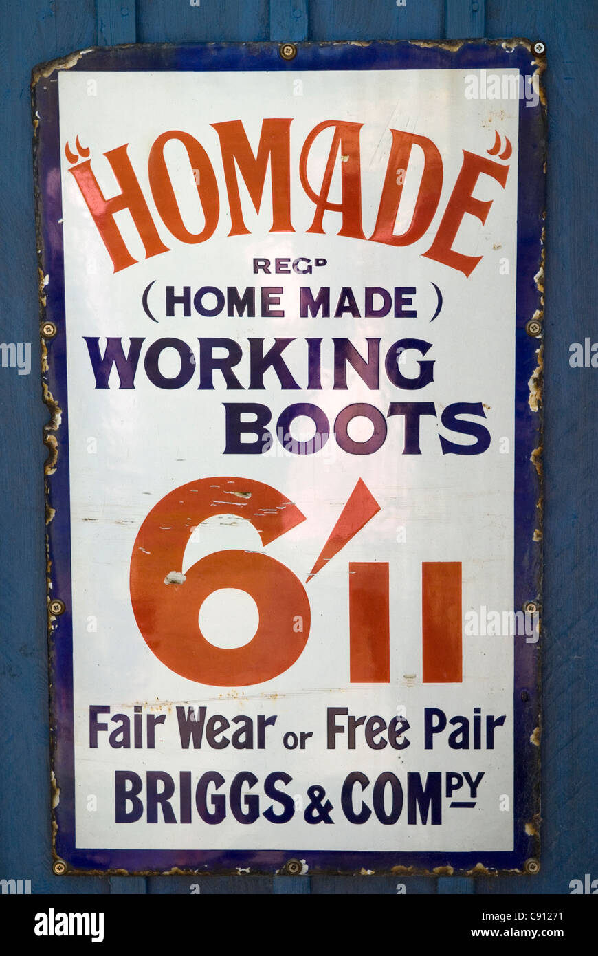 There are buildings and signs all along the Grand Union Canal and advertising signs offering working boots at a - Stock Image