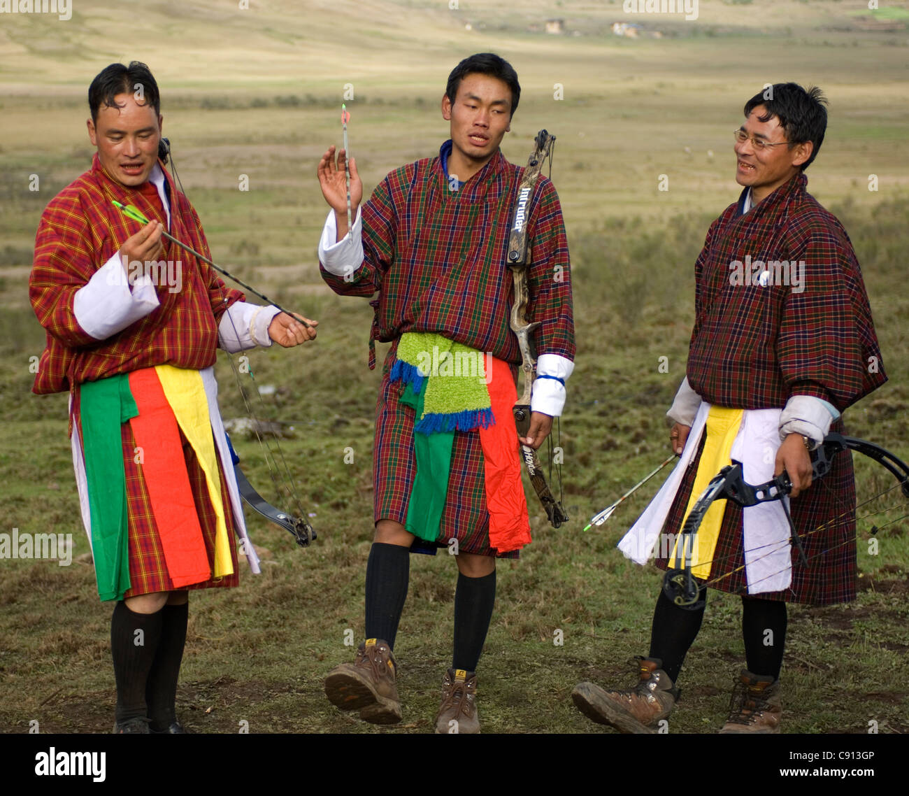 Whenever someone hits the target, members of the team in an inter-village archery contest in Bhutan do a song and - Stock Image
