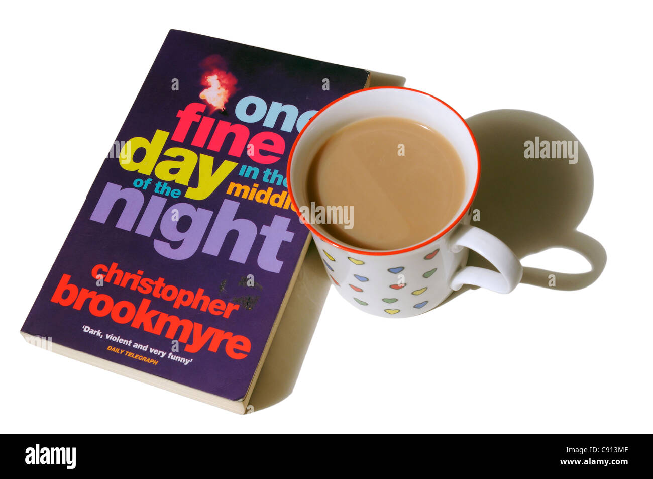 One Fine Day in the Middle of the Night by Christopher Brookmyre with a mug of tea - Stock Image