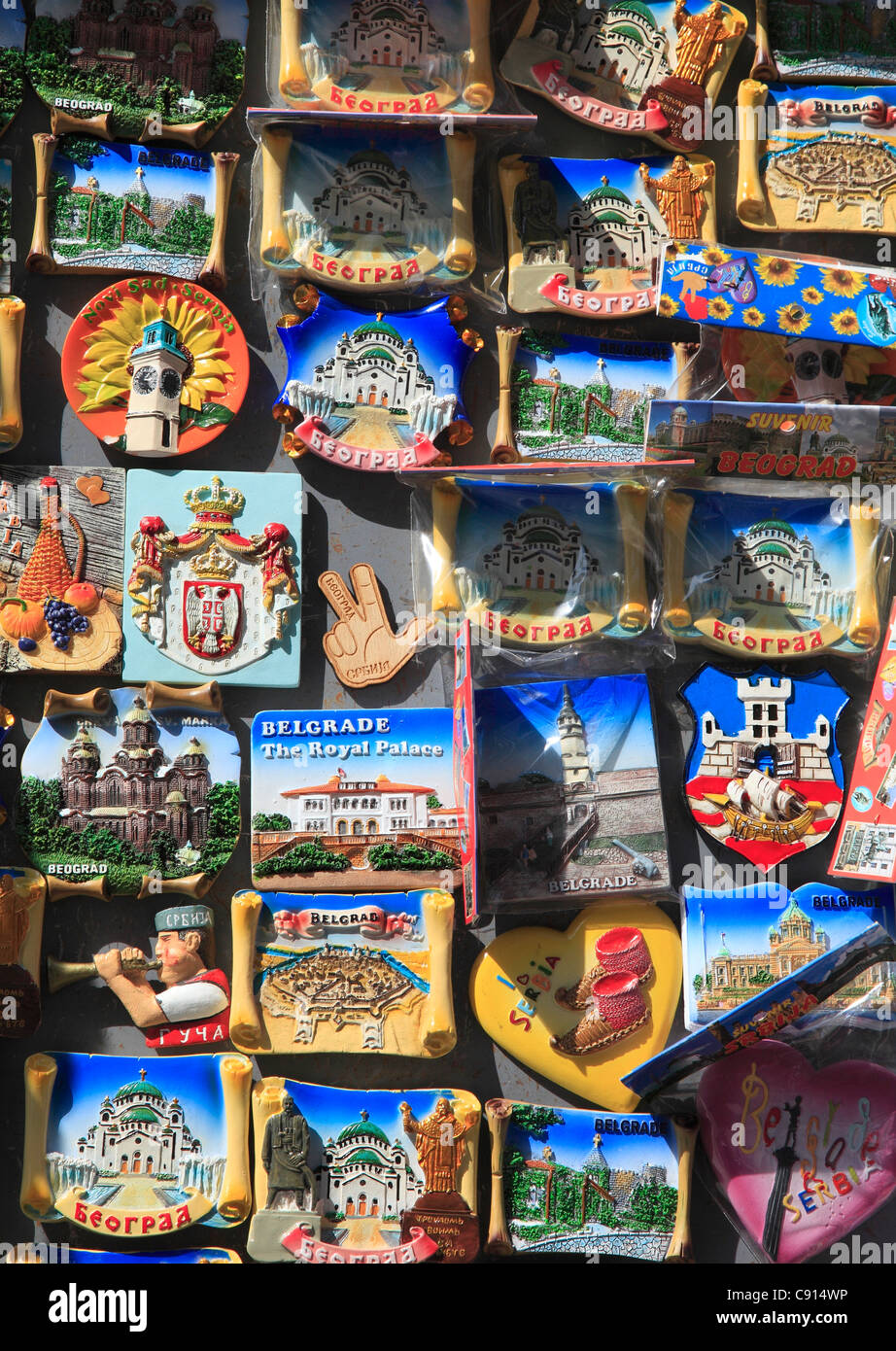 Tourist shops all over the world now sell attractive fridge magnets to tourists who want to stick them on metal - Stock Image