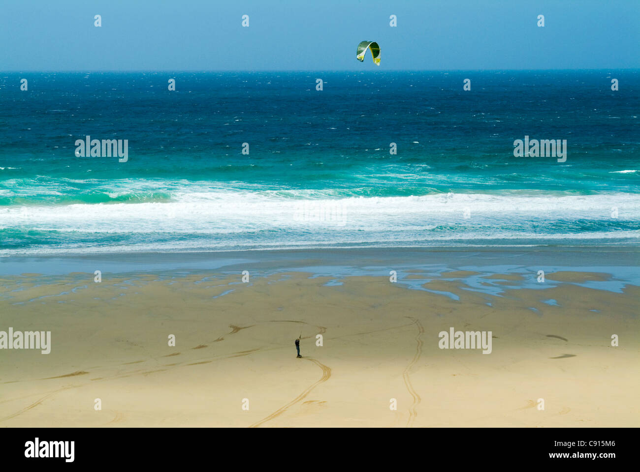 Kite landboarding is not for the nervous and the user straps his feet to an oversized skateboard with large pneumatic - Stock Image