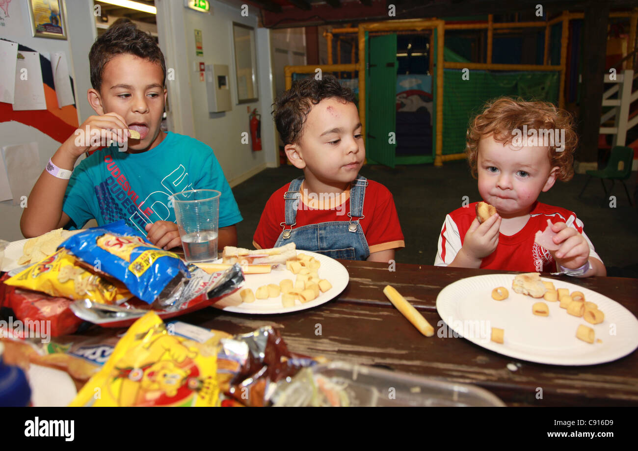 Children eating at a playgroup, UK - Stock Image