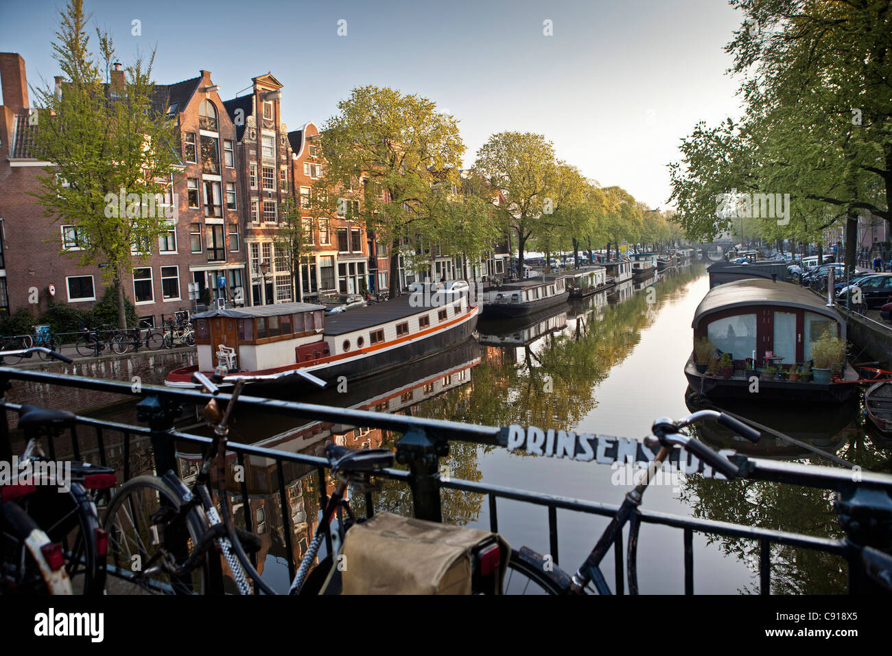 The Netherlands, Amsterdam, 17th century houses and houseboats at canal called Prinsengracht. UNESCO World Heritage Stock Photo