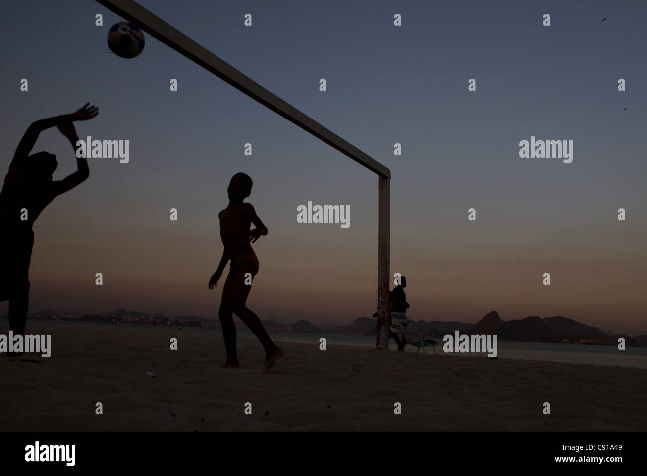 RIO DE JANEIRO, BRAZIL-JULY 15: Children playing soccer on Flamengo beach on July 15, 2010. (Photo by Lisa Wiltse/Getty - Stock Image