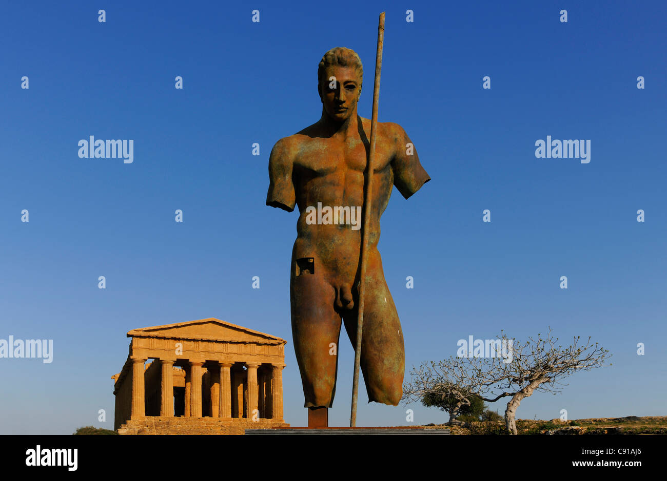 Sculpture by Igor Mitoraj, Daedalus, Concordia temple, Valle dei Templi, Agrigento, Sicily, Italy - Stock Image